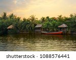 pristine riverbank at sunset ...   Shutterstock . vector #1088576441