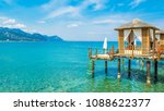 wooden beach pavilions on the... | Shutterstock . vector #1088622377