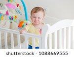 portrait of baby standing in... | Shutterstock . vector #1088669555