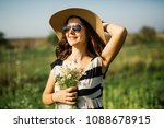 pose of a beautiful smiling... | Shutterstock . vector #1088678915