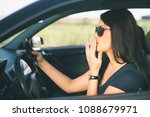 profile of a woman driver... | Shutterstock . vector #1088679971