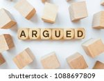 argued word on wooden cubes | Shutterstock . vector #1088697809