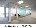 Open plan office lit by natural and artificial light - stock photo