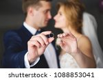 the bride and groom are holding ... | Shutterstock . vector #1088853041