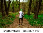 guy with backpack in the woods   Shutterstock . vector #1088874449