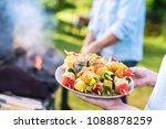 in summer. a couple prepares a... | Shutterstock . vector #1088878259