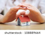 female hands saving small house ... | Shutterstock . vector #108889664