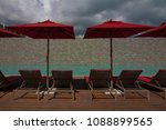 sunny day on the beach and pool ... | Shutterstock . vector #1088899565