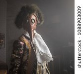 Small photo of Actor in Steam punk masks and antique costumes indoor.