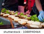 preparing hamburgers on the... | Shutterstock . vector #1088940464