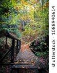 small bridge in woods | Shutterstock . vector #1088940614