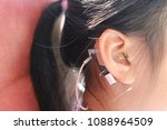 hearing loss child wearing a... | Shutterstock . vector #1088964509