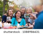 some friends in their forties... | Shutterstock . vector #1088986631