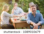 looking at the camera  a man in ... | Shutterstock . vector #1089010679