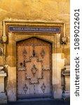 Small photo of Old Door of Schola Naturalis Philosophie( Natural Philosophy school) in University. Oxford, UK