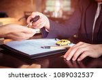 car salesman holding key to his ...   Shutterstock . vector #1089032537