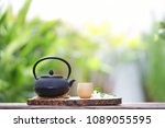 black vintage teapot and cup at ... | Shutterstock . vector #1089055595