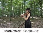 female asian violinist - stock photo