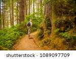 A Hiker on a trail at Oswald West State Park.  It is part of the Oregon state park system and is located about 10 miles south of the city of Cannon Beach, on the Pacific Ocean