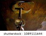 rusty old keys in the lock.... | Shutterstock . vector #1089111644