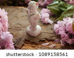 White Statue Of Angel. Flowers