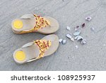 shoes  sand and seashell | Shutterstock . vector #108925937