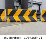 Small photo of chevron signs or object marker sign are traffic warning color yellow and black. Warn drivers of dangerous curves and obstacles