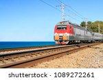 Passenger Train Goes Along The...
