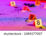 A Shell Casing Is Marked With...