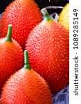 Small photo of red gac fruit