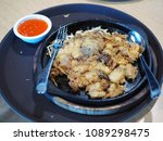 hot pan of hoi tod which is... | Shutterstock . vector #1089298475