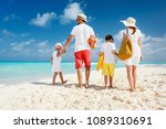 back view of a happy family on... | Shutterstock . vector #1089310691