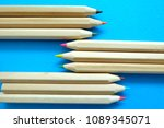 pencils on blue background. | Shutterstock . vector #1089345071