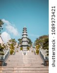 Small photo of Abrupt stairs leading to Asian pagoda - portrait background