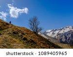 man silhouette trekking in a... | Shutterstock . vector #1089405965