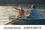young couple in a boat on a... | Shutterstock . vector #1089418079