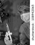 Shaded surgeon prepare make injection coming difficult surgery - stock photo