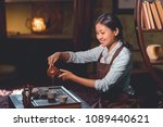 smiling tea master pouring tea... | Shutterstock . vector #1089440621