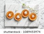 tasty tartlets with jam on... | Shutterstock . vector #1089453974