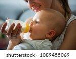 mother  feeding her baby boy... | Shutterstock . vector #1089455069