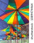 colorful umbrellas on the beach.   Shutterstock . vector #1089474464