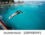 teenage boy jumping off boat...   Shutterstock . vector #1089480491