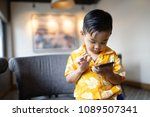 asian baby boy playing phone | Shutterstock . vector #1089507341
