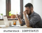 tired stressed male worker... | Shutterstock . vector #1089556925