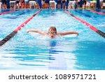 boy swimming butterfly  | Shutterstock . vector #1089571721