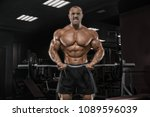 young man train in the gym... | Shutterstock . vector #1089596039