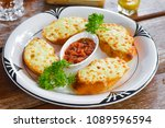 garlic bread with cheese and... | Shutterstock . vector #1089596594