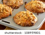 Walnut and banana muffins in a baking tray.  Delicious, wholesome eating. - stock photo