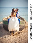 wedding couple in a boat on the ... | Shutterstock . vector #1089605114