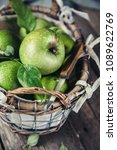 green apples in old basket and... | Shutterstock . vector #1089622769